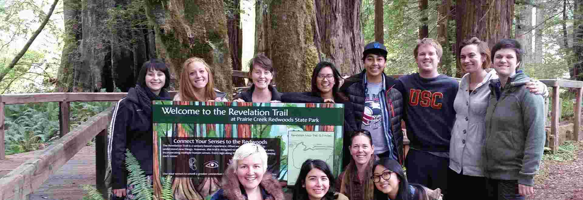 Humboldt State University students proudly showing their work of new interpretive signs on the Revelation Trail of Prairie Creek Redwoods State Park